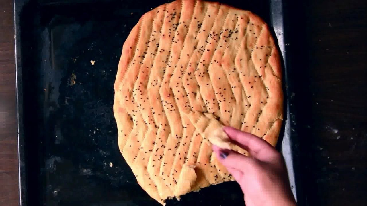 Image of the cooking step-2-10 for Afghan Naan Bread Recipe - Naan-e-Afghani (Video)