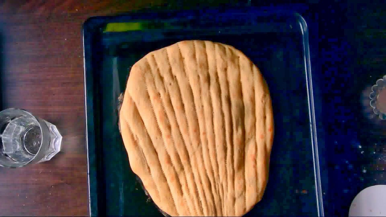 Image of the cooking step-2-8 for Afghan Naan Bread Recipe - Naan-e-Afghani (Video)