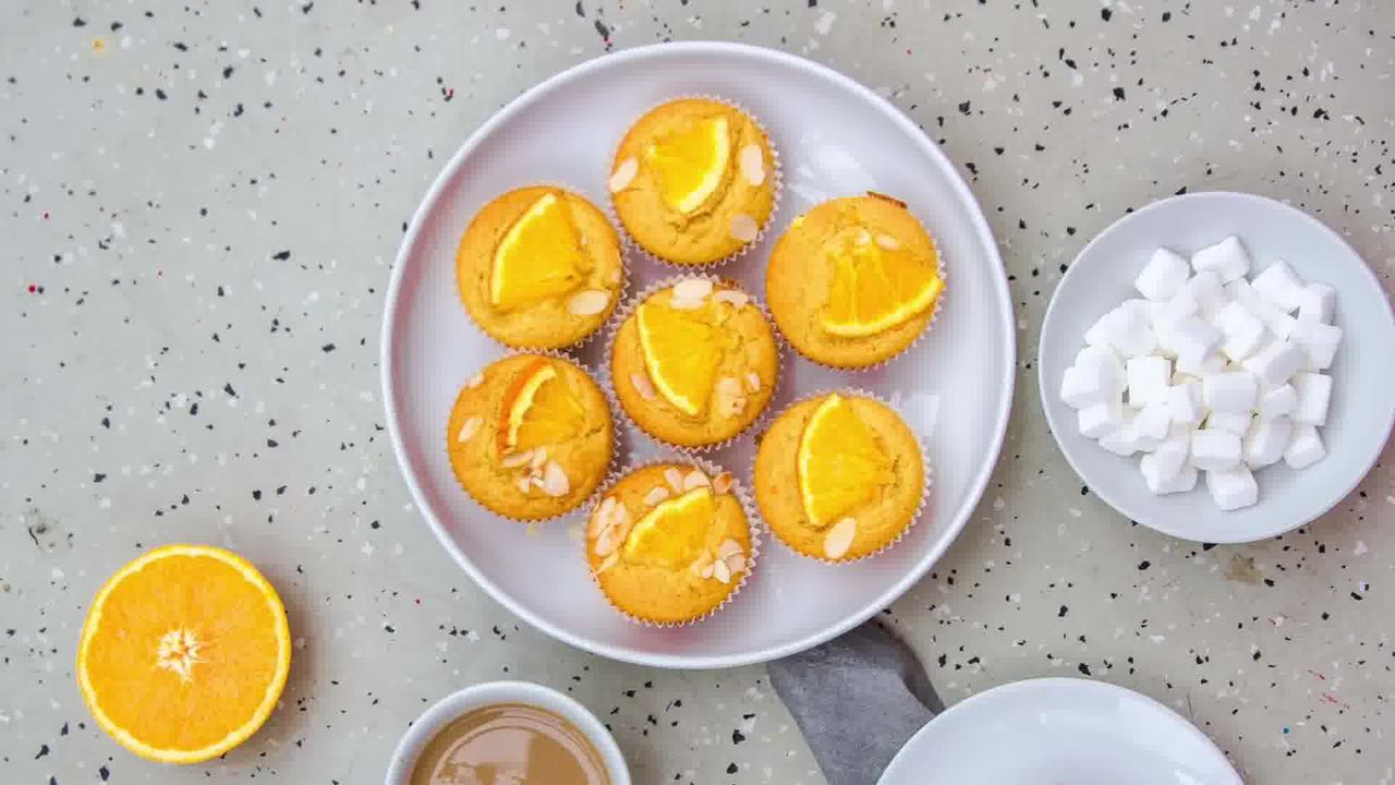 Image of the cooking step-1-11 for Orange Olive Oil Muffins Recipe - Eggless