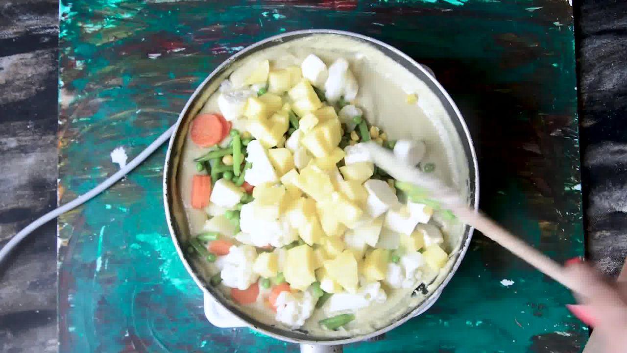 Image of the cooking step-4-9 for Mughlai Navratan Korma - White Gravy Navratan Kurma