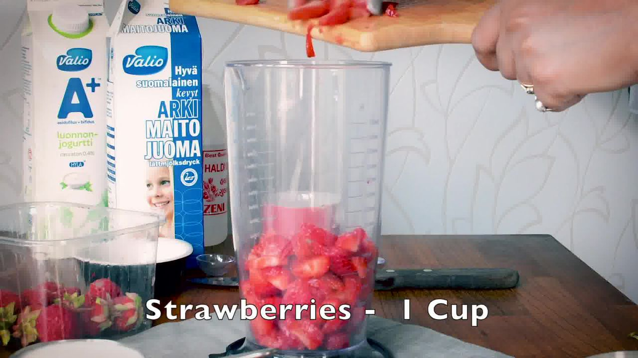 Image of the cooking step-1-1 for Strawberry Lassi Recipe - Strawberry Yogurt Smoothie