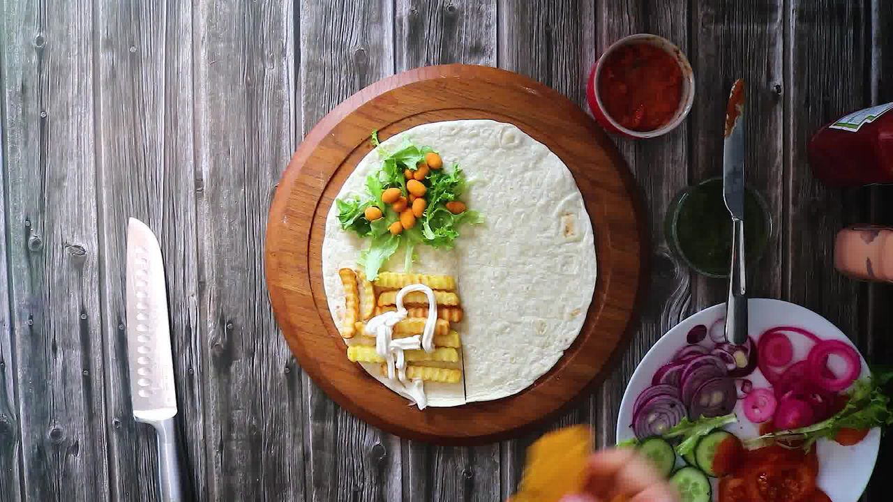 Image of the cooking step-3-3 for TikTok Tortilla Wrap Hack (6 Vegetarian Filling Ideas)