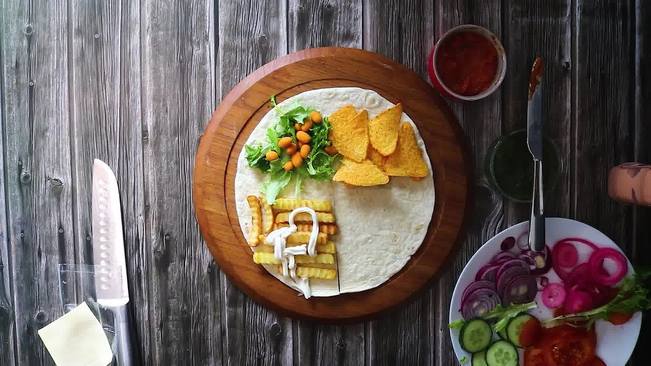 Image of the cooking step-3-4 for TikTok Tortilla Wrap Hack (6 Vegetarian Filling Ideas)