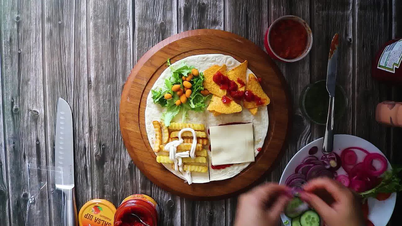 Image of the cooking step-3-5 for TikTok Tortilla Wrap Hack (6 Vegetarian Filling Ideas)