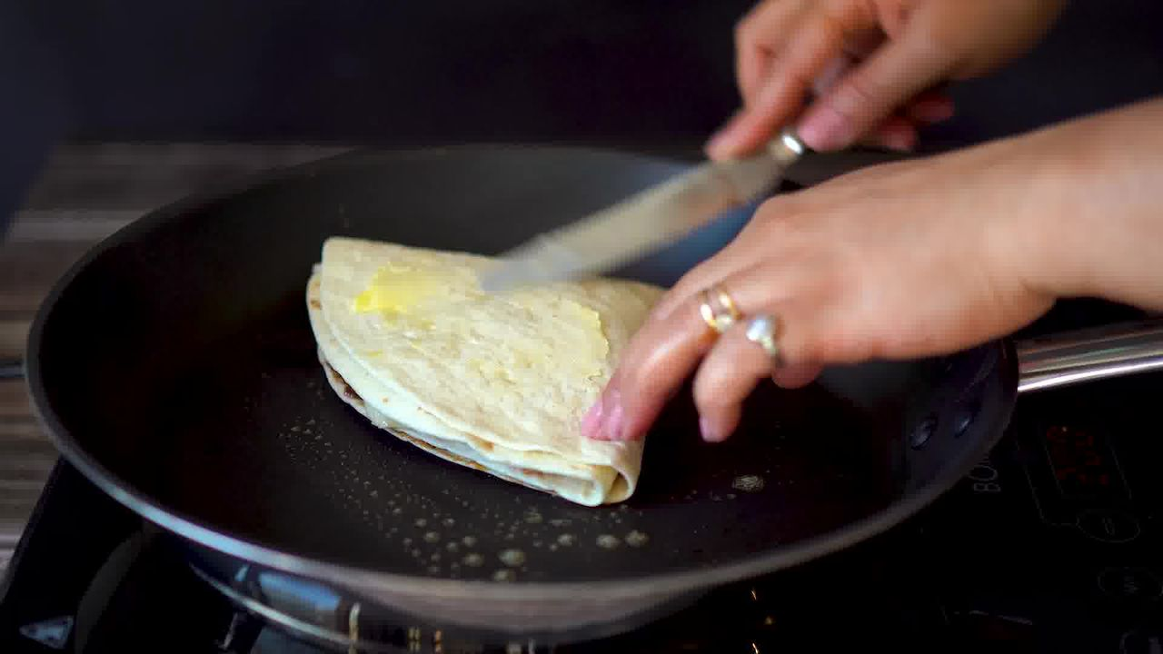 Image of the cooking step-6-6 for TikTok Tortilla Wrap Hack (6 Vegetarian Filling Ideas)