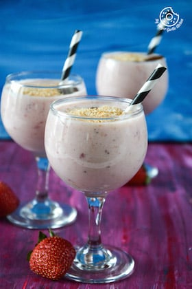 Image of Coconut Milk Banana Strawberry Smoothie Topped With Toasted Coconut