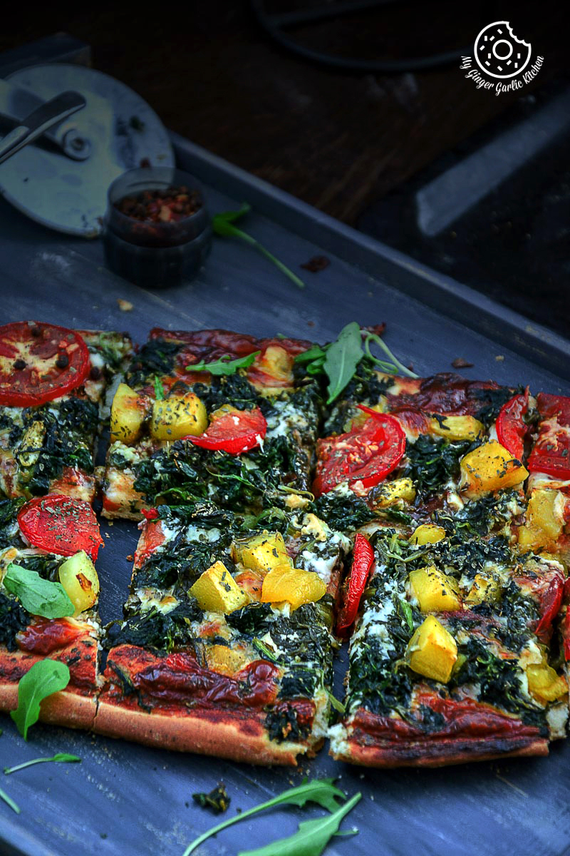 Image - recipe Garlicky Spinach Mango Tomato Pizza with Hot Pepper Sauce and Flakes anupama paliwal my ginger garlic kitchen 61 683x1024