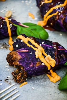 Image of Potato Paneer Stuffed Roasted Red Cabbage Cones with Sriracha Sauce