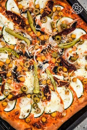 Image of Chickpea Zucchini Mushroom Pizza with Pickled Peppers and Olives