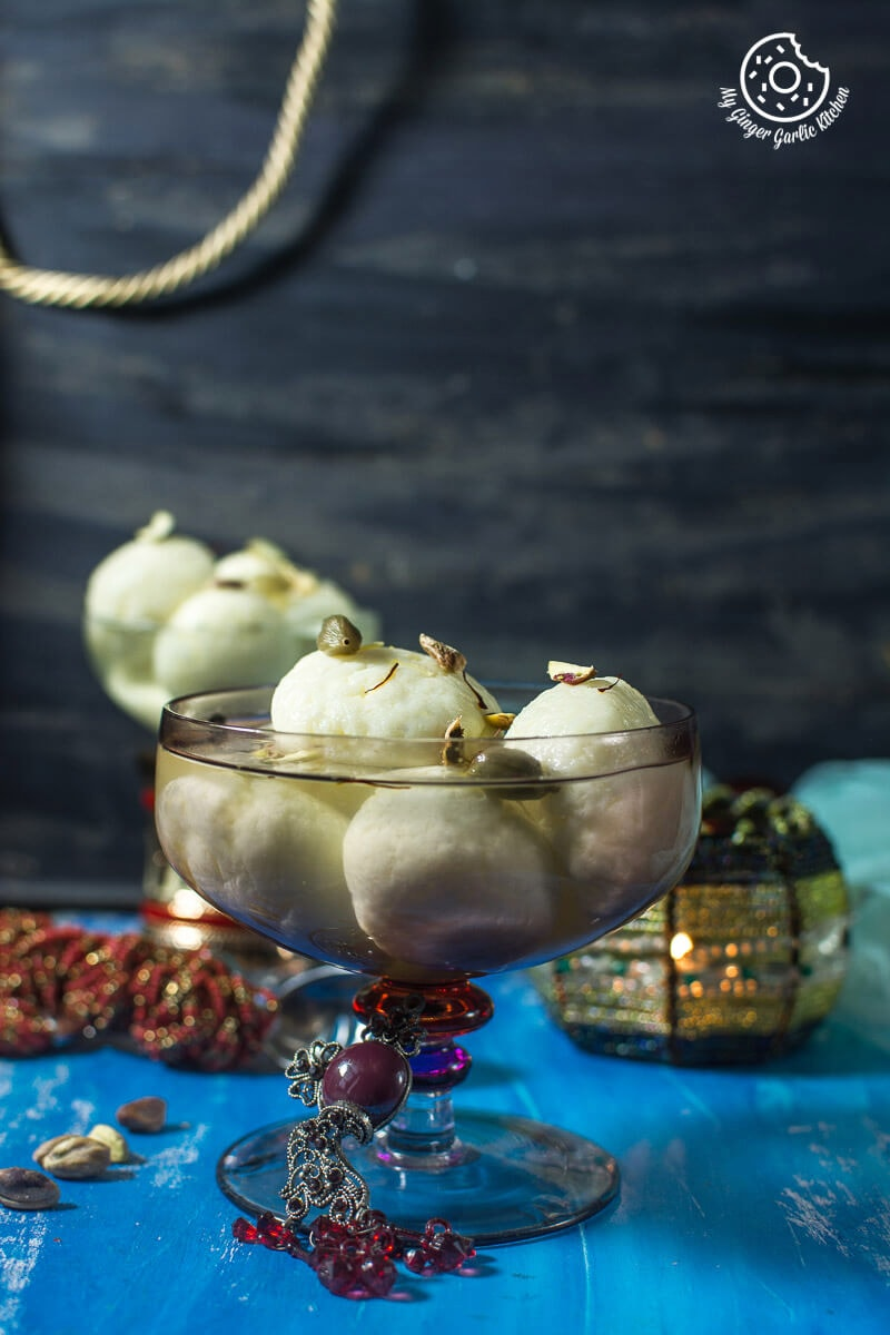 rasgulla garnished with saffron strands and pistachio