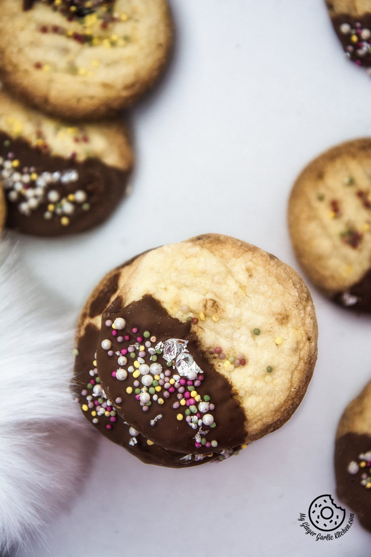 Chocolate Dipped Whipped Shortbread Cranberry Cookies | mygingergarlickitchen.com/ @anupama_dreams