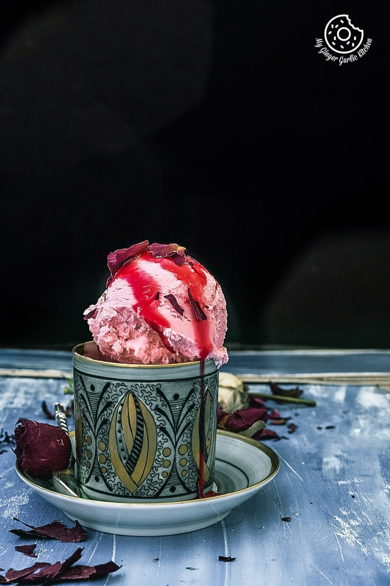 rose ice cream served in an ethnic cup and saucer