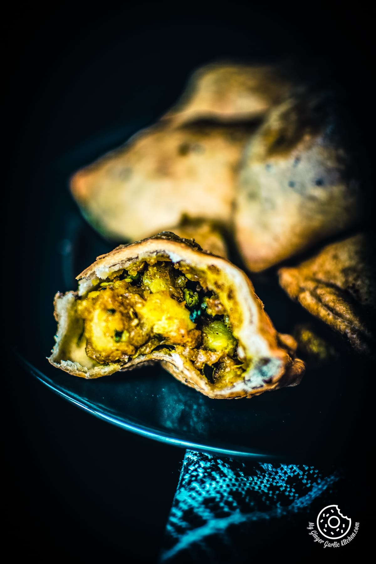 a closeup shot of aloo samosa broken into