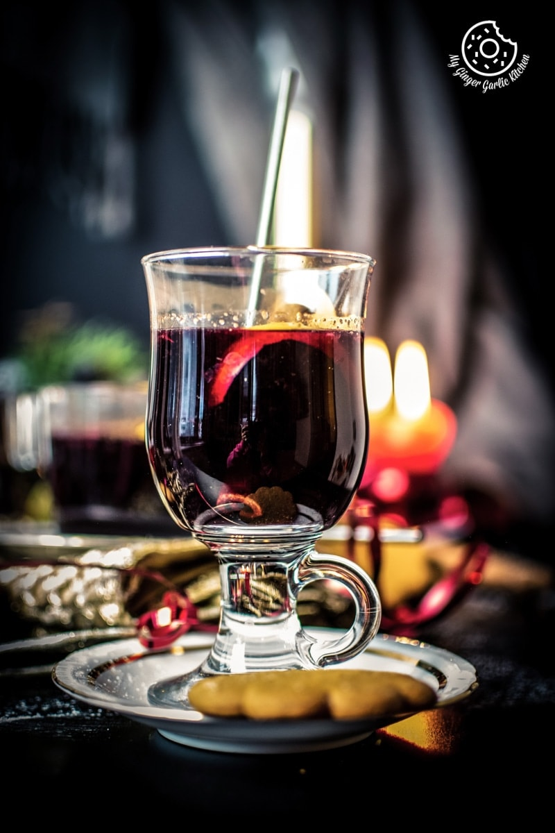 warm mulled wine served in a transparent tall glass
