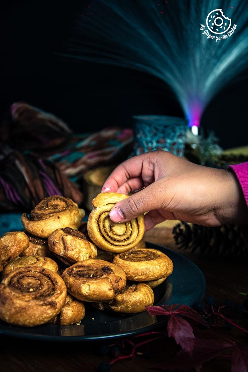 a hand holding a bhakarwadi