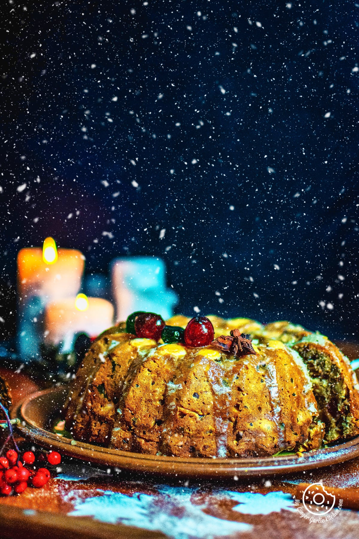 beautiful snow flakes falling on a fruit cake