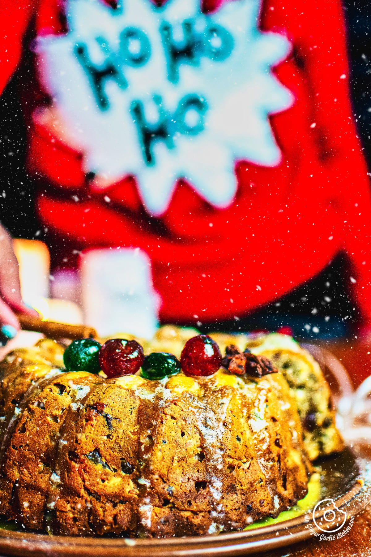 a person decorating a fruit cake