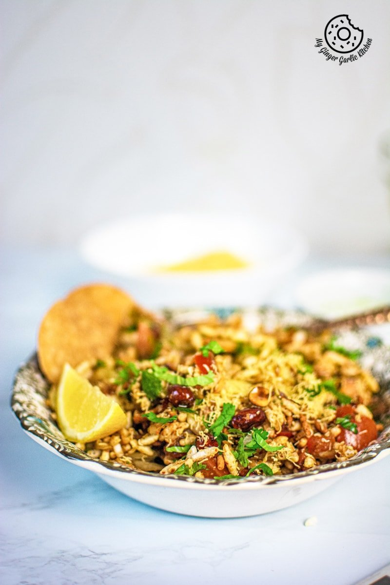 bhel puri served in a floral plate