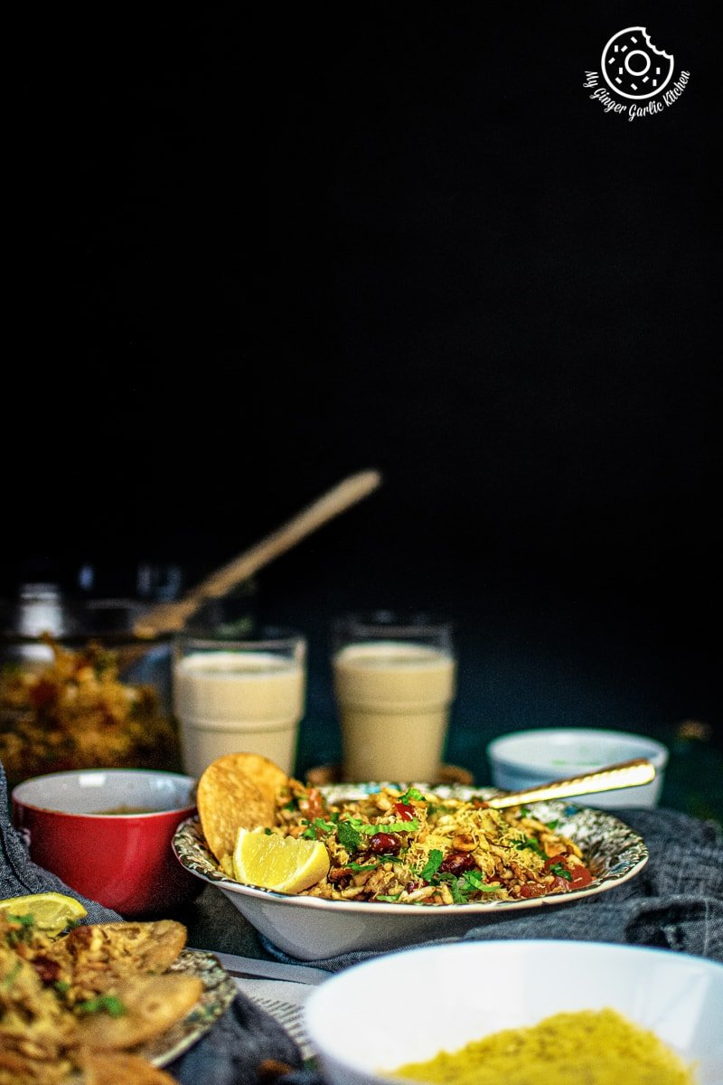 bhelpuri served in a plate and two tea glasses in the background