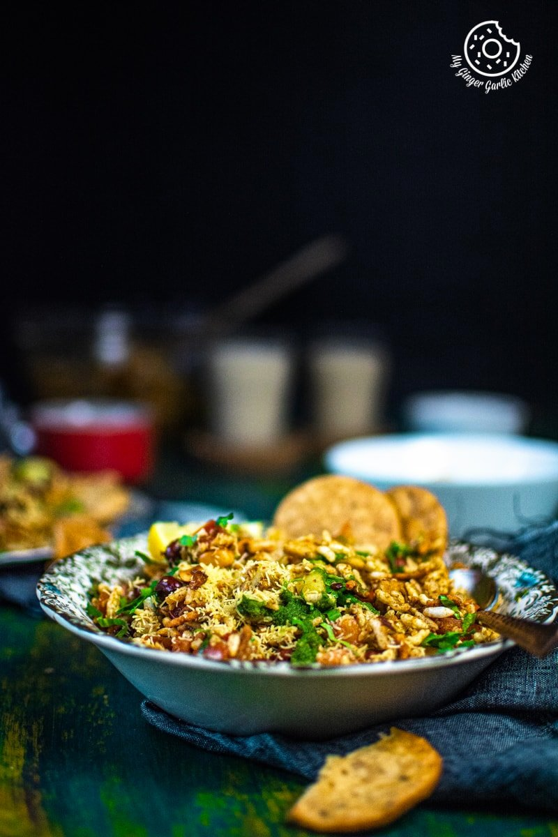 bhelpuri bowl kept on a green board