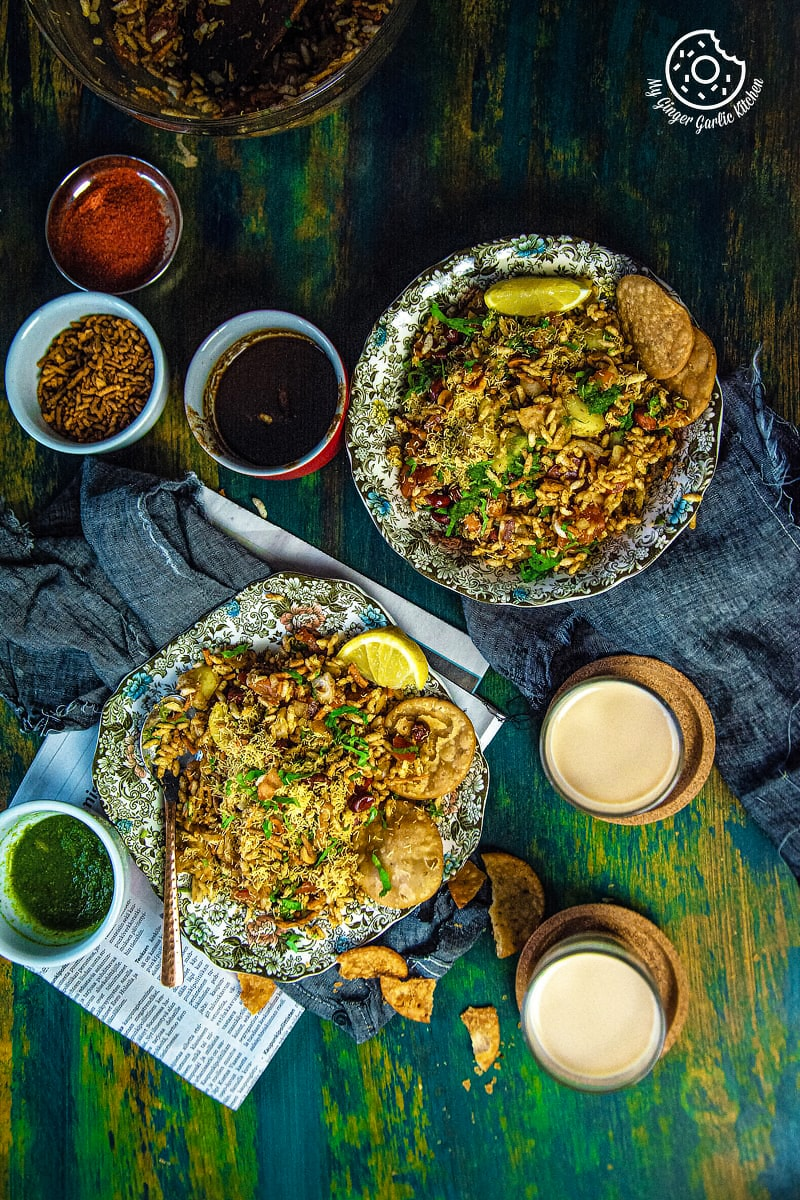 overhead shot of bhelpuri plates and tea glasses