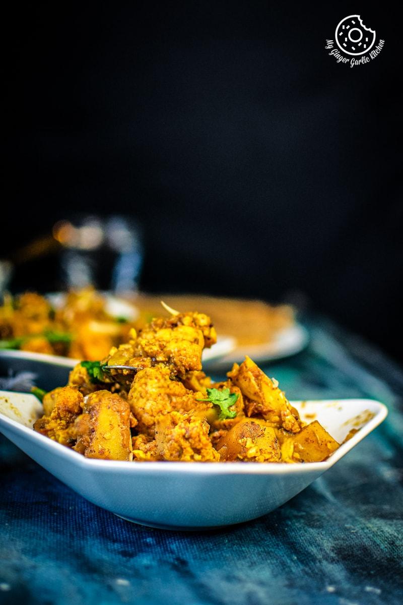 dry aloo gobi sabzi served in a bowl