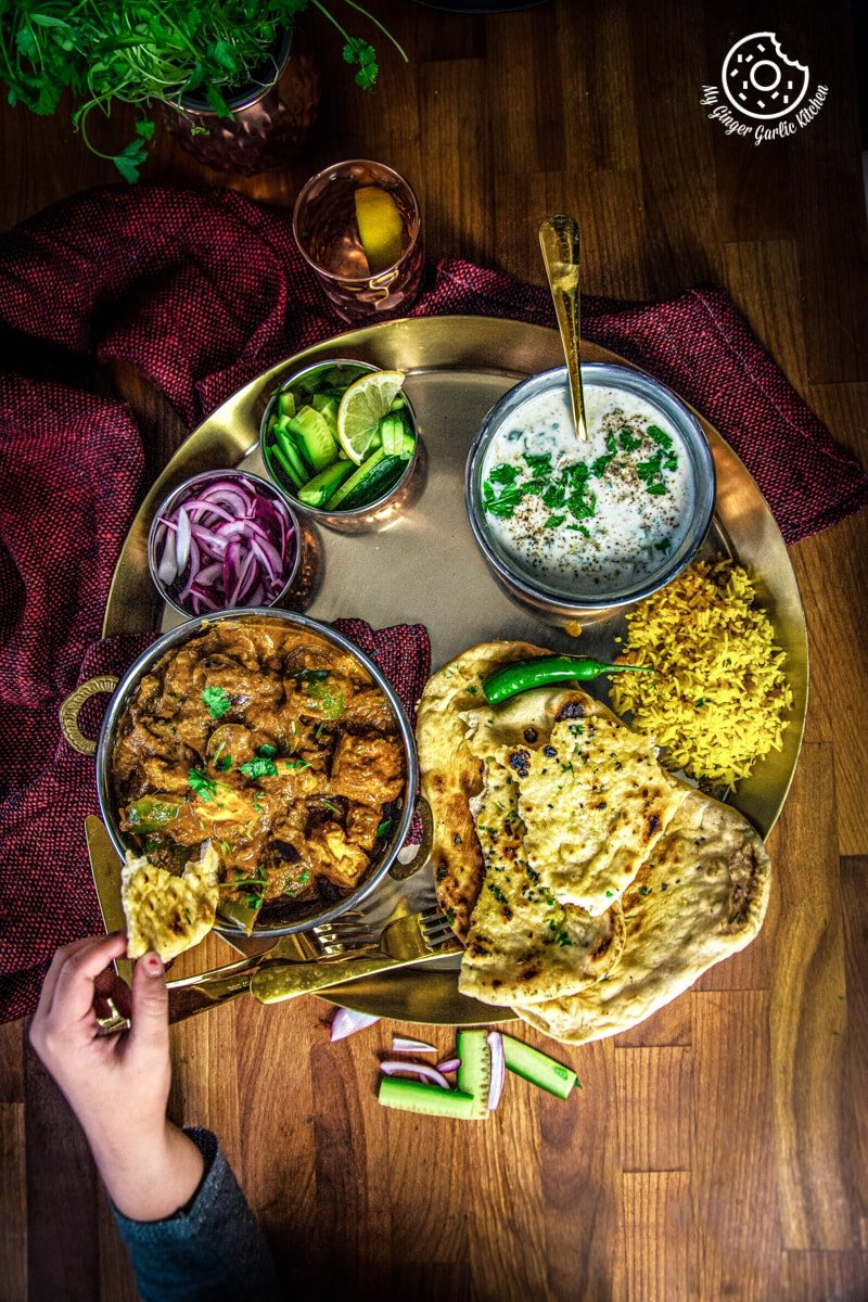 overhead shot of indian thali with kadai paneer