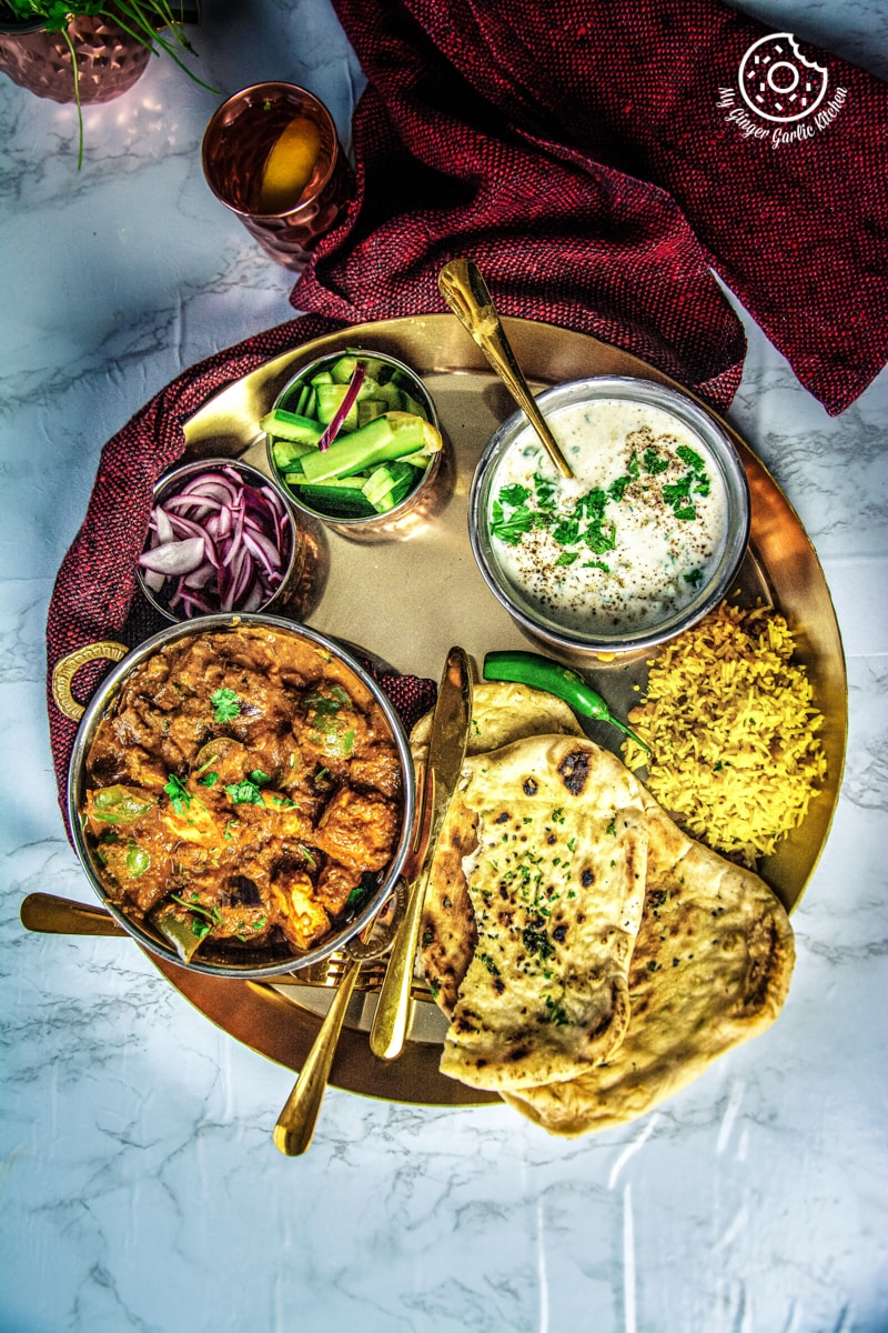 kadai paneer served in a golden thali