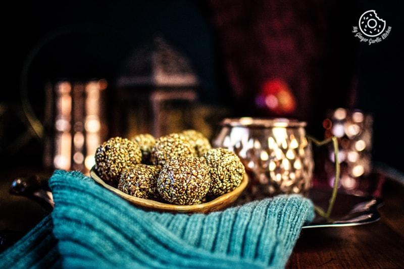 til laddu bowl kept on a grey woolen fabric