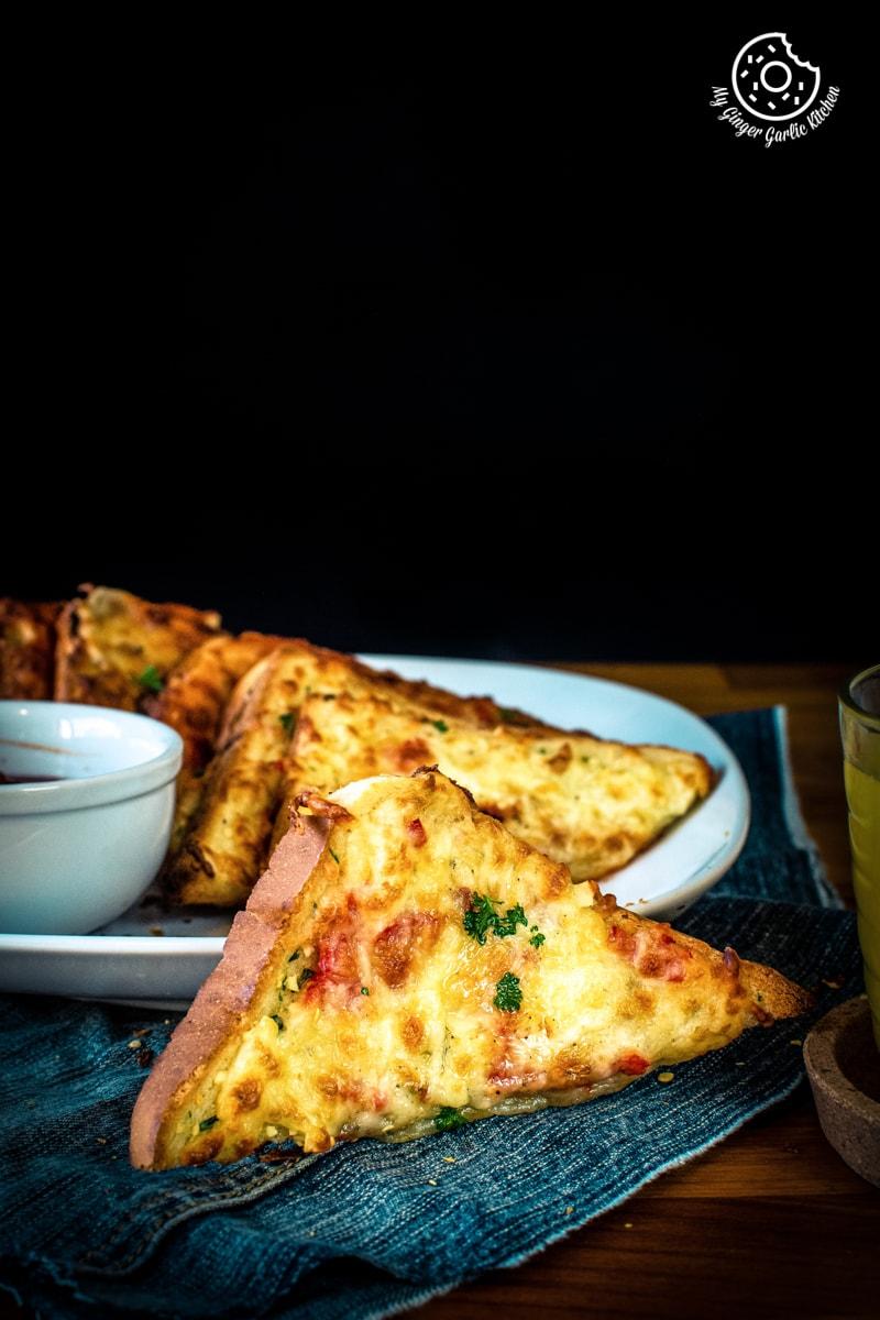chilli cheese toast shot on a dark background
