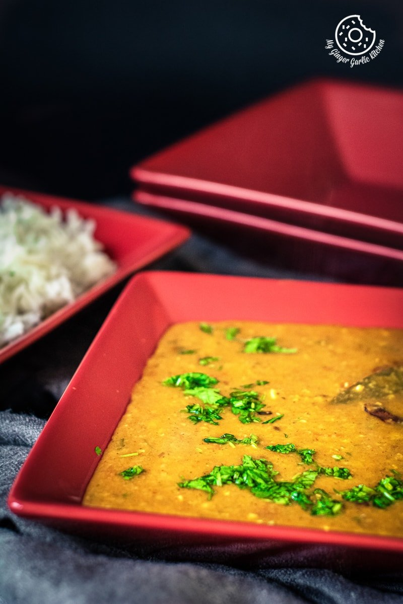 instant pot masoor dal tadka served in a red dish