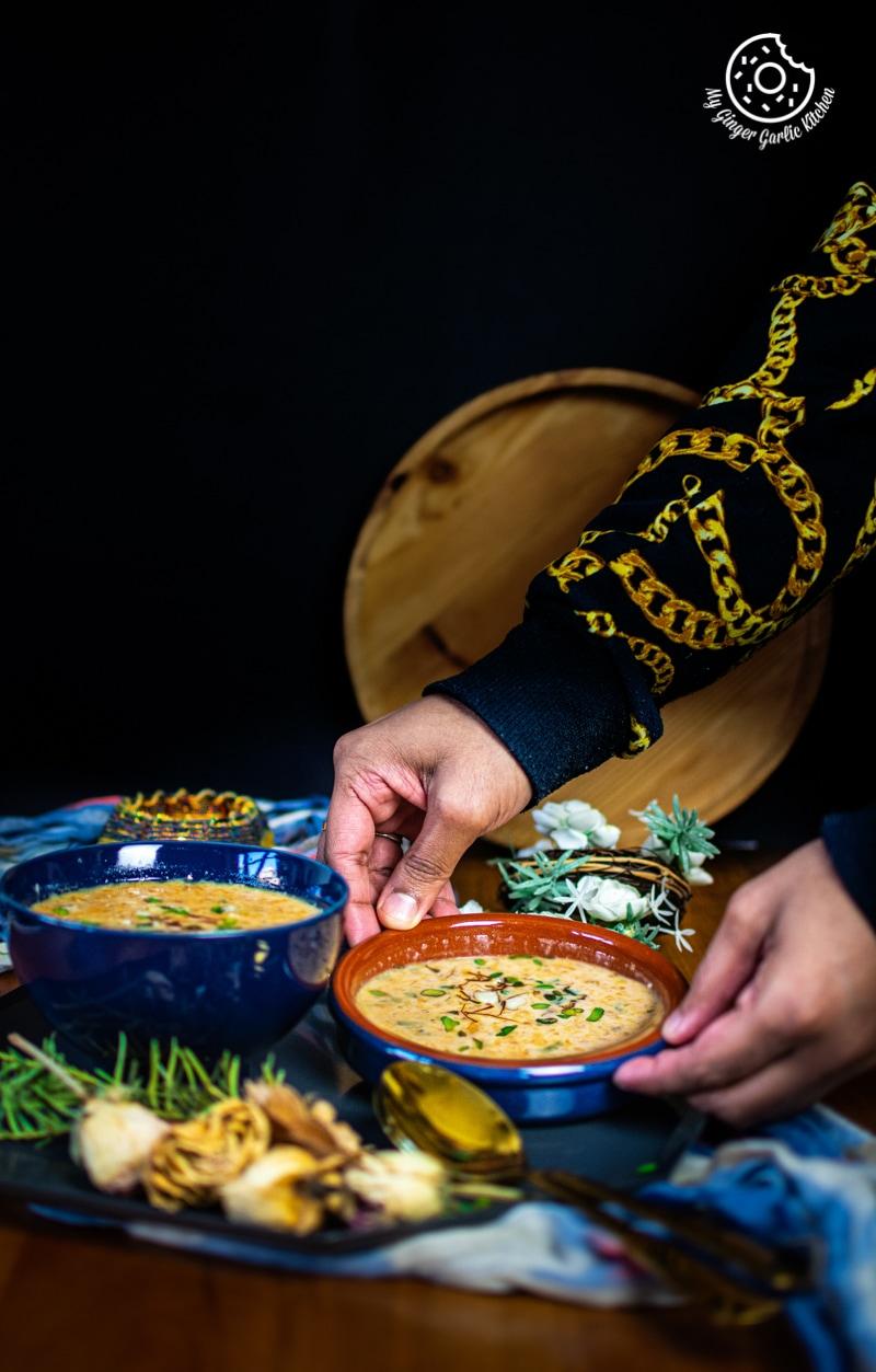 a man holding motichoor laddu kheer bowl
