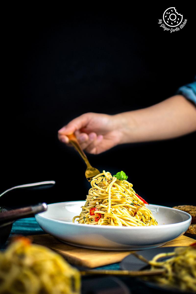 pasta aglio e olio served in a white plate