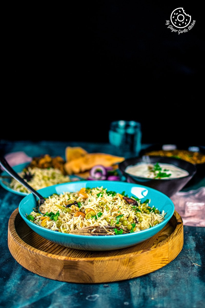 matar pulao served in a light blue plate
