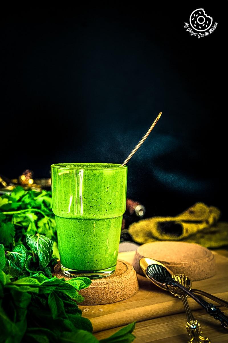green mint coriander chutney served in a glass jar