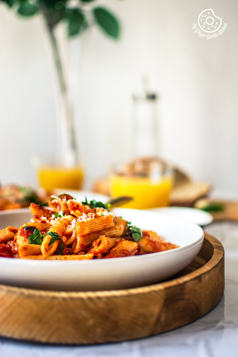 pasta arrabiata served in a white plate