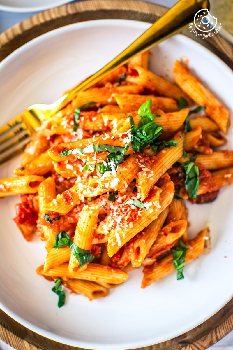 penne arrabbiata served in a white plate
