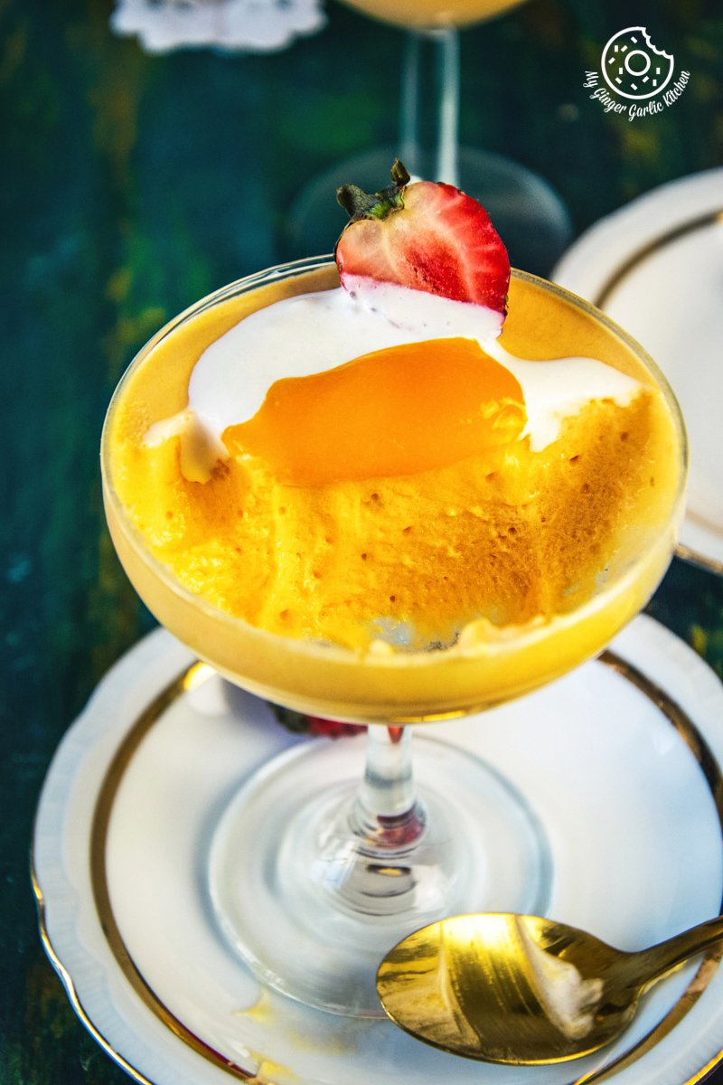 eggless mango mousse served in dessert glasses