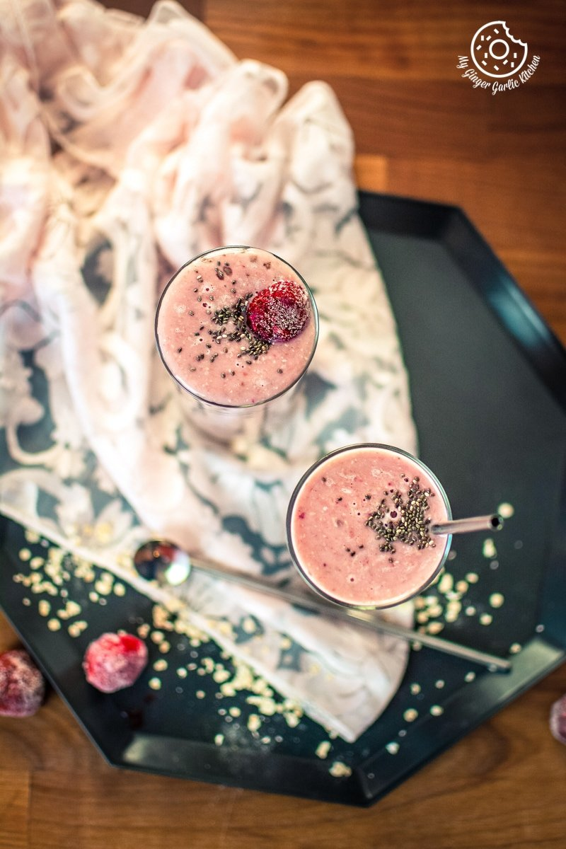 strawberry banana oat smoothie served in tall glasses