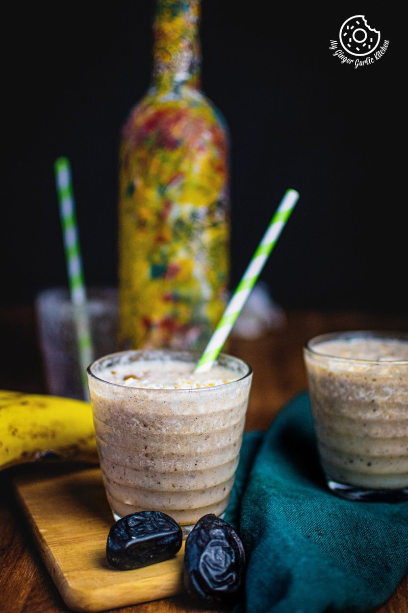 banana date smoothie glass with a straw