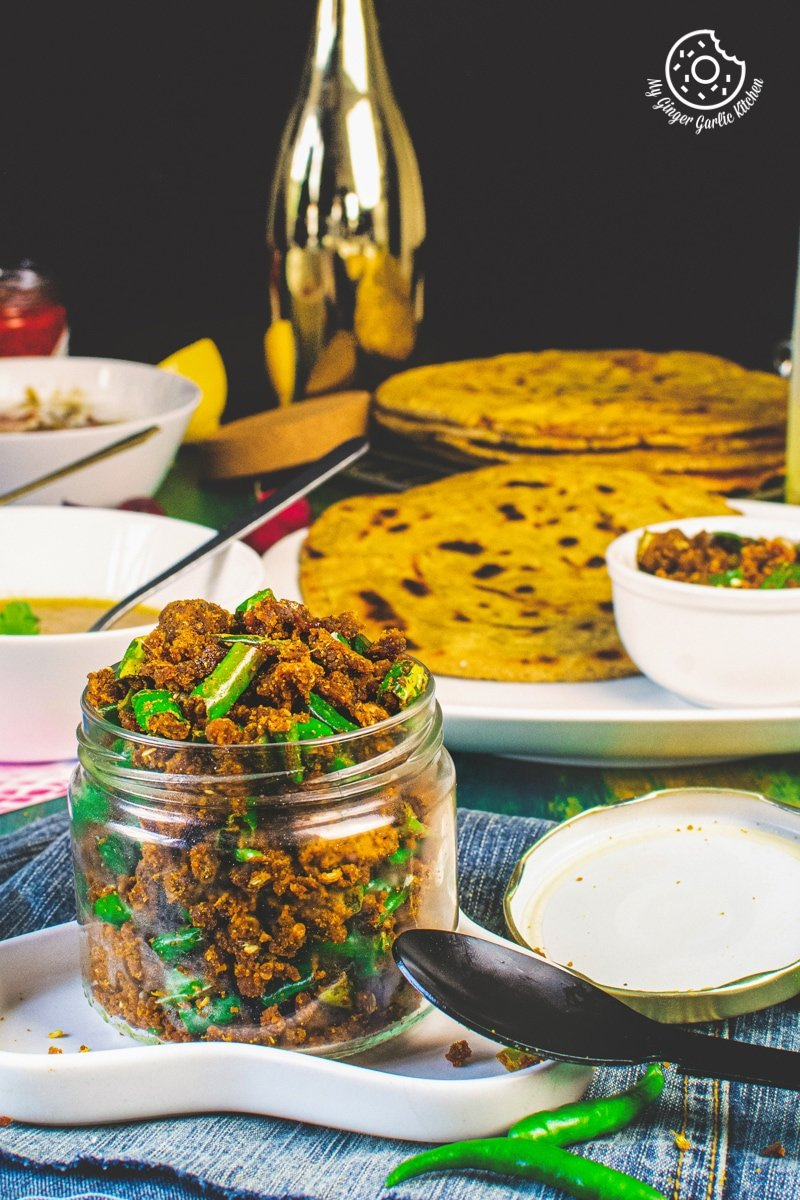 besan mirchi ke tipore in a glass jar