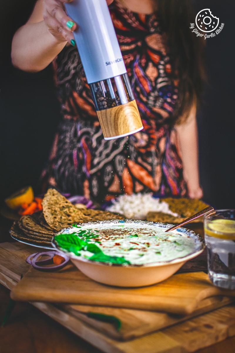 cucumber raita served in a bowl
