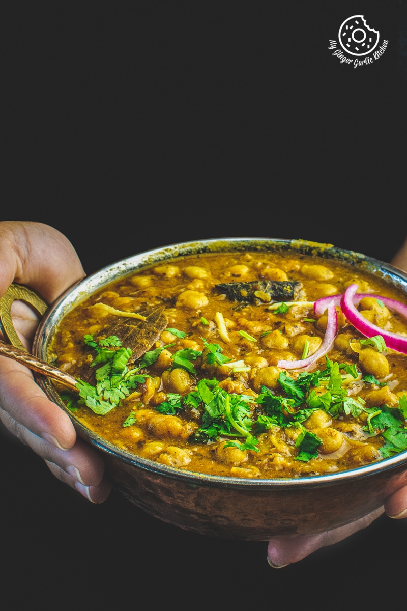 instant pot chana masala served in a copper bowl