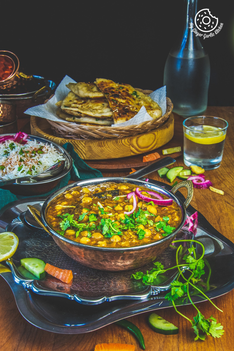 instant pot chole masala served in a copper bowl