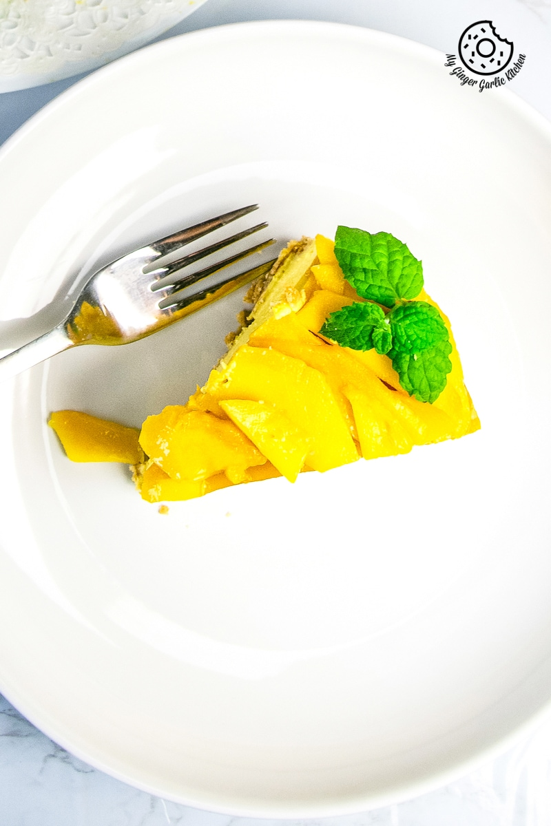 no bake mango cheesecake slice served in white plate