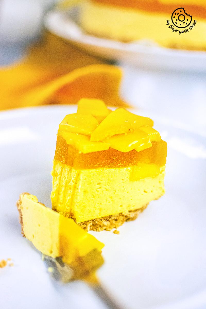 no bake mango cheesecake slice served in white plate