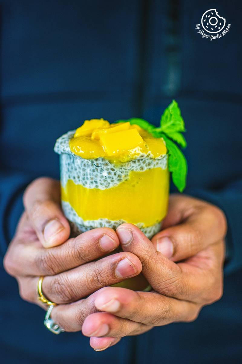 coconut mango chia pudding topped with mangoes
