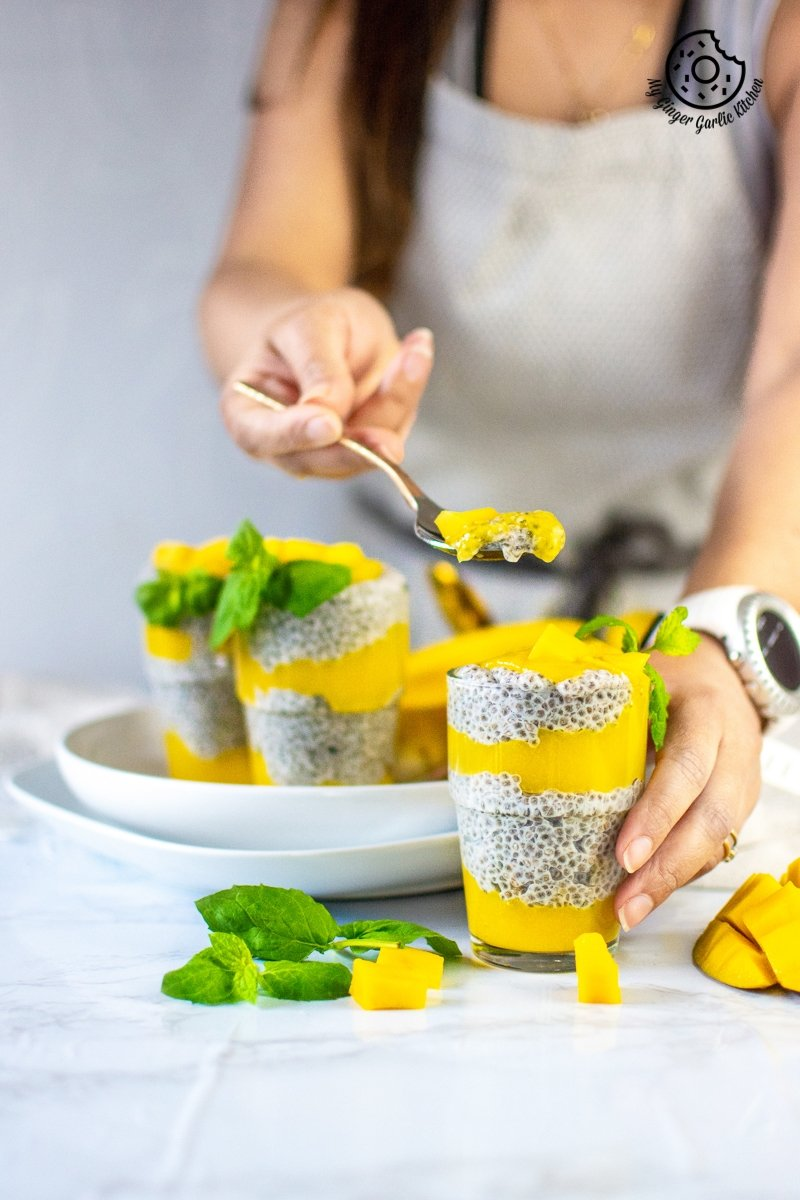 coconut mango chia pudding served in a glass