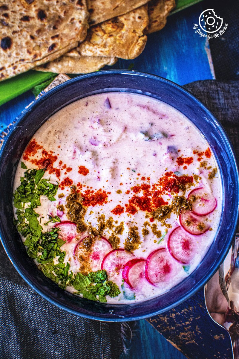 overhead shot of mooli raita serve in a bowl