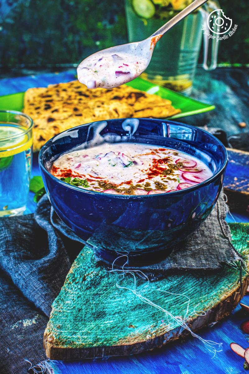 radish raita served in blue a bowl